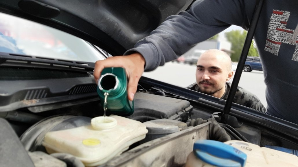 What fluids should I check before driving on a road trip