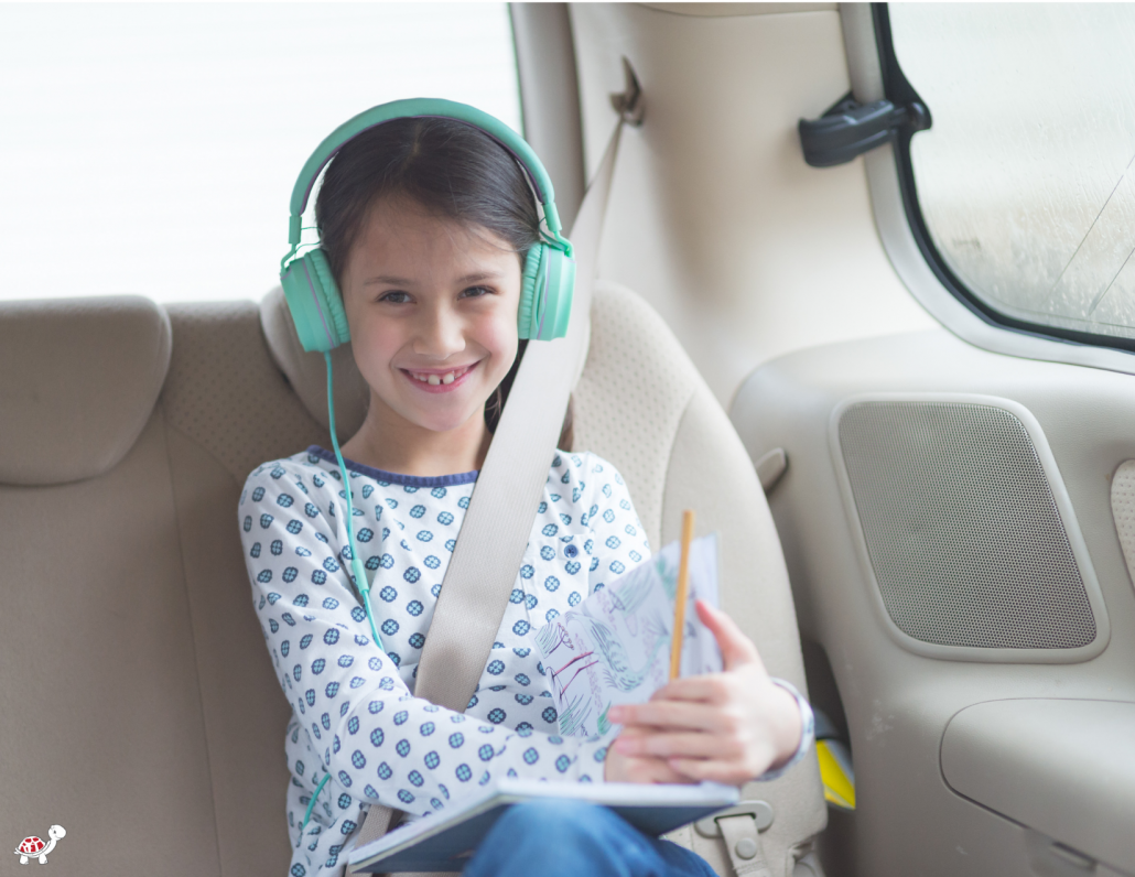 Audiobooks with headphones for Family Road Trip