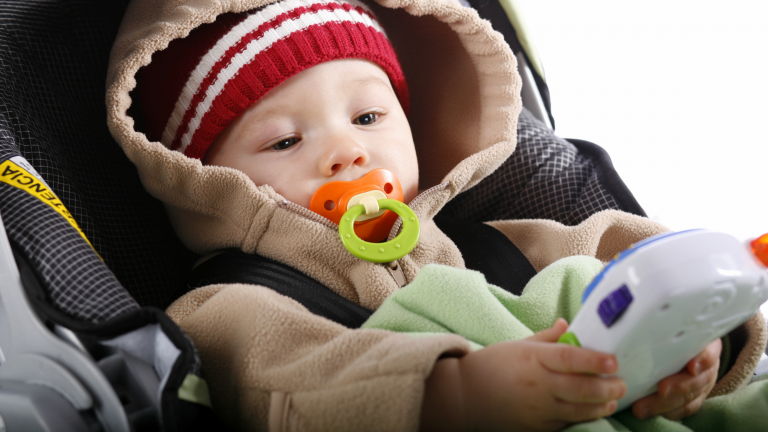 Baby in Car Seat with Travel Toy