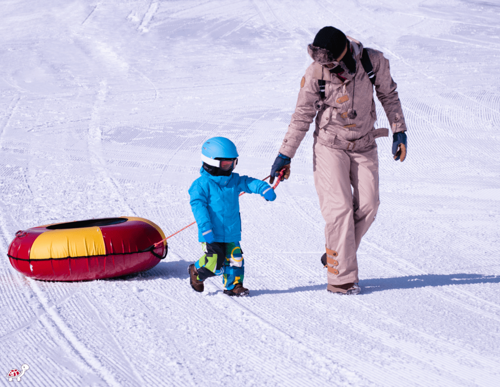 Snow Tube with Child in WNC