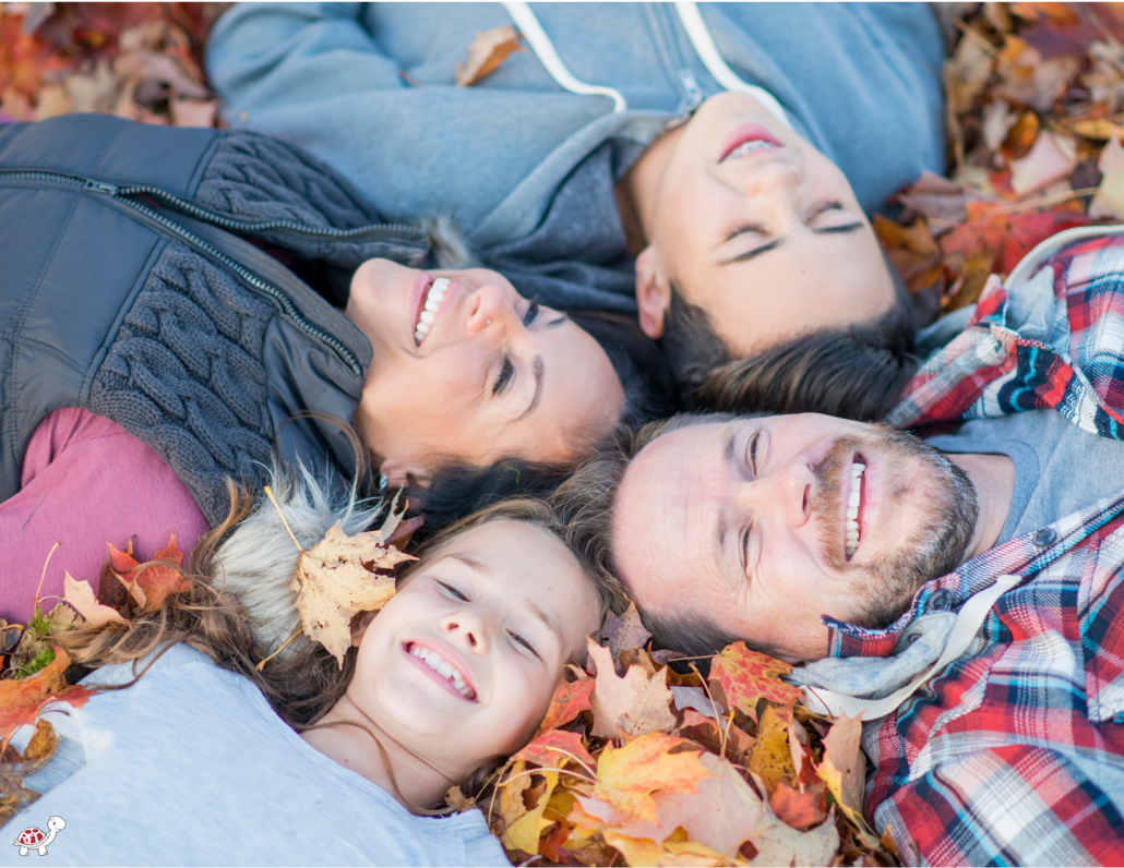 family in autumn leaves
